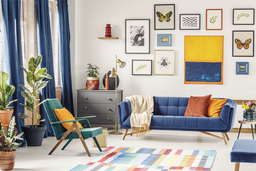 Plant On Grey Cabinet Next To Suede Sofa Under Yellow And Blue Painting In  Flat Interior