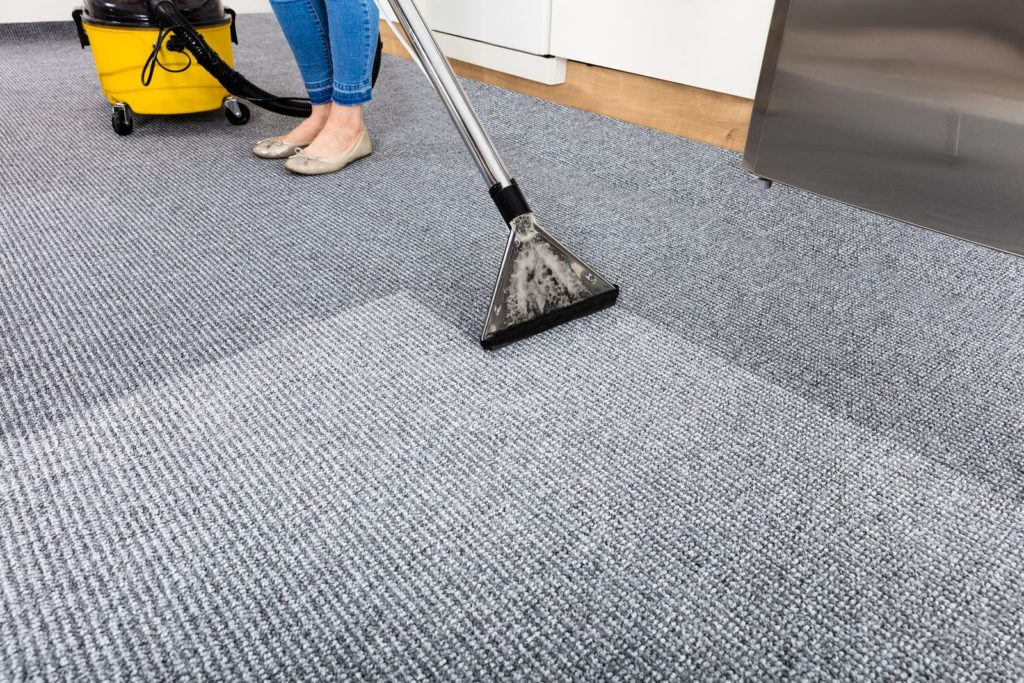 Vacuuming carpet cleaning
